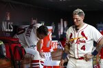 St. Louis Cardinals' Yadier Molina (4) and Adam Wainwright are seen in the dugout during the seventh inning of Game 2 of the baseball National League Championship Series against the Washington Nationals Saturday, Oct. 12, 2019, in St. Louis. (AP Photo/Jeff Roberson)