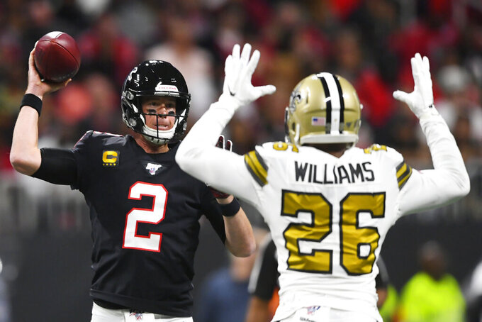 Atlanta Falcons quarterback Matt Ryan (2) tries to pass against New Orleans Saints cornerback P.J. Williams (26) during the first half of an NFL football game, Thursday, Nov. 28, 2019, in Atlanta. (AP Photo/John Amis)