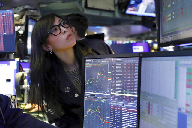 Specialist Erica Fredrickson works on the floor of the New York Stock Exchange, Monday, March 9, 2020. The Dow Jones Industrial Average sank 7.8%, its steepest drop since the financial crisis of 2008, as a free-fall in oil prices and worsening fears of fallout from the spreading coronavirus outbreak seize markets. (AP Photo/Richard Drew)