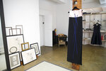 In this Sept. 4, 2019, photo, a dress designed by Herve Pierre, meant for Emmy-nominated actress Jessica Hecht to wear at the Creative Arts Emmy Awards, hangs at Atelier Caito for Herve Pierre in New York. (AP Photo/Mary Altaffer)
