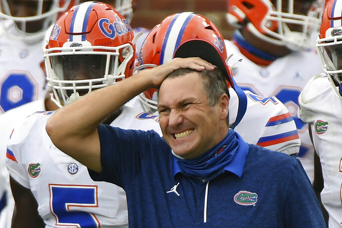 Florida head coach Dan Mullen reacts during the second half of an NCAA college football game against Mississippi in Oxford, Miss., Saturday, Sept. 26, 2020. Mullen was given several more chances Monday, Oct. 12, 2020, to walk back bizarre comments about wanting to pack 90,000 screaming fans inside Florida Field during the coronavirus pandemic. He declined each of them, brushing aside criticism and insisting he's focused on defending national champion LSU.  (AP Photo/Thomas Graning)