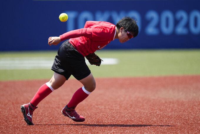 Japanese softball player Kawabata Hitomi misses the ball during the team's training session at the Fukushima Azuma Baseball Stadium ahead of the 2020 Summer Olympics, Tuesday, July 20, 2021, in Fukushima, Japan. (AP Photo/Jae C. Hong)