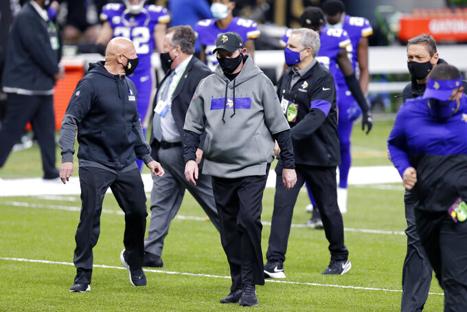 Minnesota Vikings head coach Mike Zimmer walks off the filed at the end of the first half of an NFL football game against the New Orleans Saints in New Orleans, Friday, Dec. 25, 2020. (AP Photo/Brett Duke)