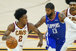Cleveland Cavaliers' Collin Sexton (2) drives against Los Angeles Clippers' Paul George (13) during the first half of an NBA basketball game Wednesday, Feb. 3, 2021, in Cleveland. (AP Photo/Tony Dejak)