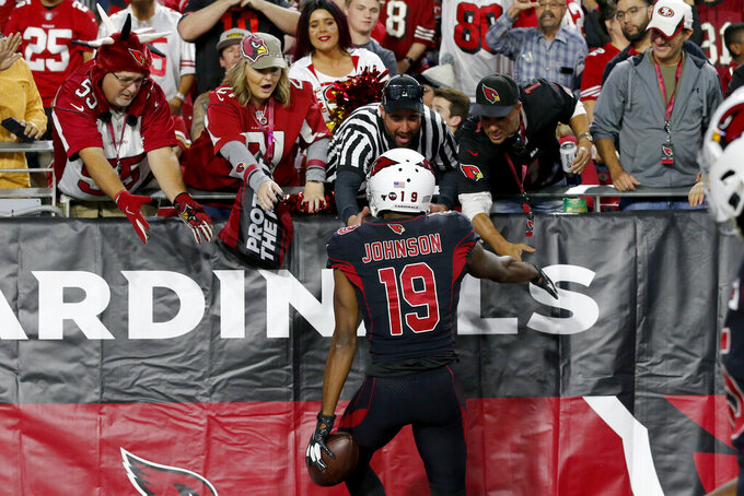 Arizona Cardinals wide receiver KeeSean Johnson (19) celebrates his touchdown against the San Francisco 49ers with fans during the second half of an NFL football game, Thursday, Oct. 31, 2019, in Glendale, Ariz. (AP Photo/Rick Scuteri)
