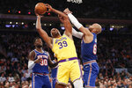 New York Knicks forward Taj Gibson (67) grabs Los Angeles Lakers center Dwight Howard (39) as Knicks forward Julius Randle (30) watches, left, during the first half of an NBA basketball game in New York, Wednesday, Jan. 22, 2020. (AP Photo/Kathy Willens)