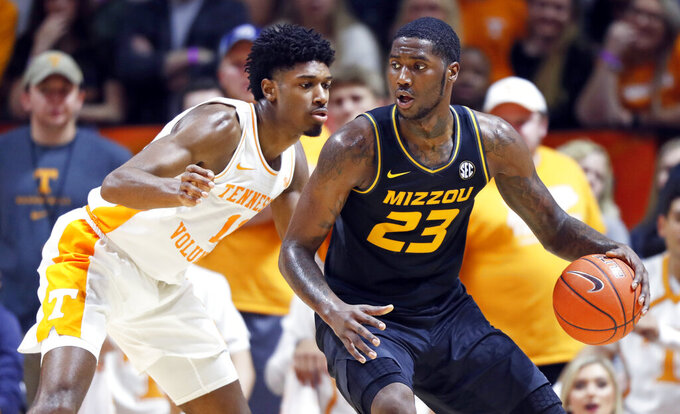 Missouri forward Jeremiah Tilmon (23) works for a shot as he's defended by Tennessee forward Kyle Alexander (11) during the first half of an NCAA college basketball game Tuesday, Feb. 5, 2019, in Knoxville, Tenn. (AP photo/Wade Payne)