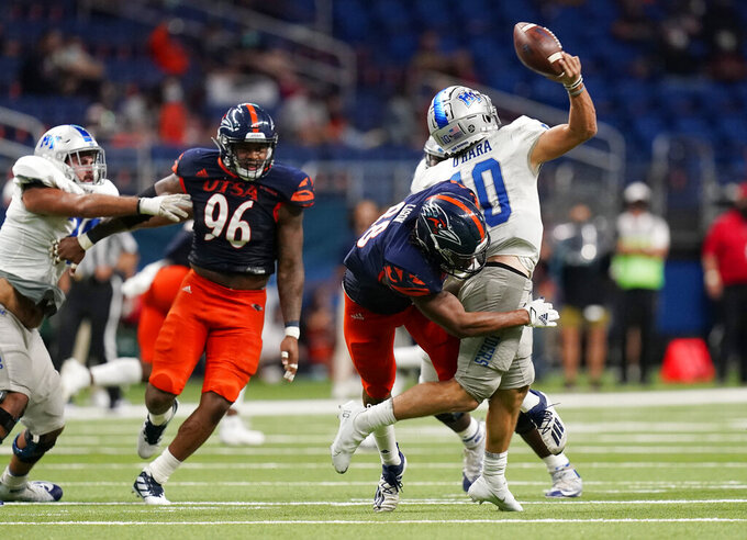 Middle Tennessee quarterback Asher O'Hara (10) is hit by UTSA linebacker Jamal Ligon (88) as he tries to throw during the second half of an NCAA college football game Friday, Sept. 25, 2020, in San Antonio. (AP Photo/Eric Gay)
