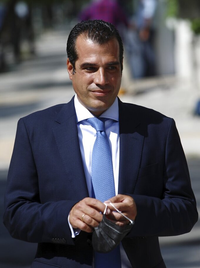 """New Health Minister Athanassios Plevris arrives at the Presidential Palace in Athens, Greece, Tuesday, Aug. 31, 2021. Greece's new rightwing health minister apologized Wednesday, Sept. 1, 2021 for past remarks the country's Jewish community had taken strong issue with, and avowed his """"absolute respect"""" for Holocaust victims and his opposition to antisemitism. (Dimitris Kapadais/InTime News via AP)"""