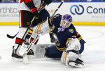 Buffalo Sabres goalie Linus Ullmark (35) makes a save during the first period of the team's NHL hockey game against the Ottawa Senators, Saturday, Nov. 16, 2019, in Buffalo, N.Y. (AP Photo/Jeffrey T. Barnes)