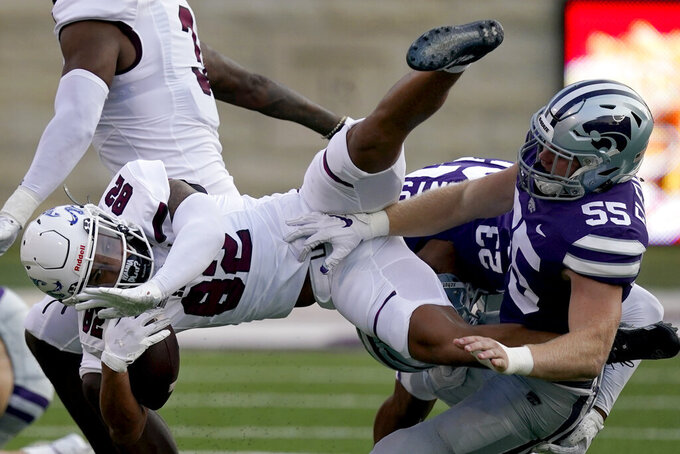 Southern Illinois wide receiver Izaiah Hartrup (82) is tacked by Kansas State linebacker Cody Fletcher (55) during the first half of an NCAA college football game, Saturday, Sept. 11, 2021, in Manhattan, Kan.(AP Photo/Charlie Riedel)