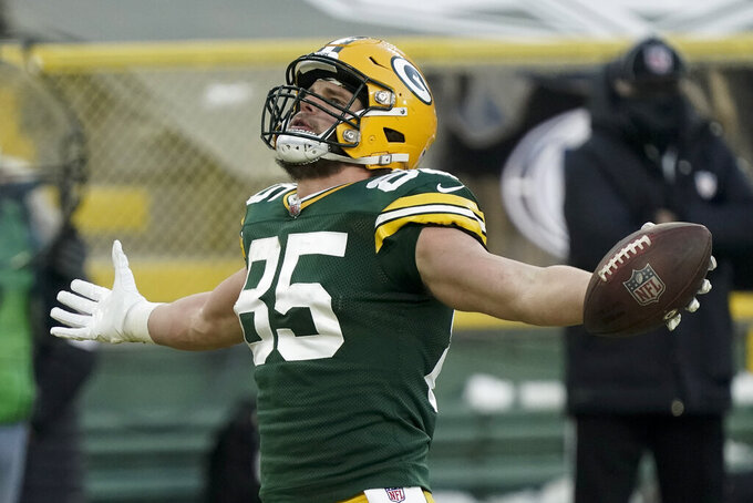 Green Bay Packers' Robert Tonyan celebrates after catching an eight-yard touchdown pass against the Tampa Bay Buccaneers during the second half of the NFC championship NFL football game in Green Bay, Wis., Sunday, Jan. 24, 2021. (AP Photo/Morry Gash)