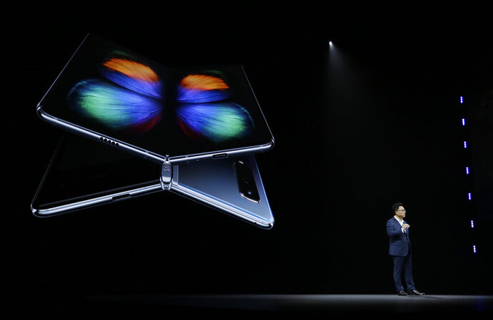 DJ Koh, Samsung President and CEO of IT and Mobile Communications, talks about the new Samsung Galaxy Fold smartphone during an event Wednesday, Feb. 20, 2019, in San Francisco. (AP Photo/Eric Risberg)