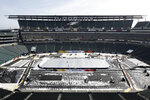 An insulated tarp covers the ice ahead of the NHL Winter Classic hockey game between the Pittsburgh Penguins and Philadelphia Flyers, in Philadelphia, Thursday, Feb. 21, 2019. When the Flyers host the Penguins on Saturday at Lincoln Financial Field, it'll be the 27th NHL outdoor game since 2003, and next season's Winter Classic is at the Cotton Bowl in Dallas. There's no fear of the variable climate in Texas in early January and almost no limit to where these games can go. (AP Photo/Matt Rourke)