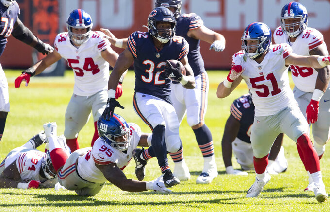Chicago Bears running back David Montgomery (32) runs against New York Giants linebacker Kyler Fackrell (51) in the fourth quarter of an NFL football game Sunday, Sept. 20, 2020, in Chicago. (Brian Cassella/Chicago Tribune via AP)
