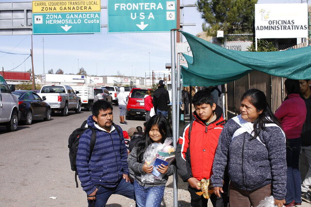 "The Gonzalez family of five from Guatemala, who are applying for asylum in the U.S., stand for a family portrait before going to a soup kitchen to eat in Nogales, Mexico, on the U.S. border, Friday, Jan. 3, 2020. The family was sent by U.S. authorities to Nogales, Mexico on Thursday as part of the so-called ""Remain in Mexico"" program, and have a court appointment in El Paso on March 23. Lorenzo Gonzalez said the five of them were separated while being processed in the U.S. immigration system, after they turned themselves in to authorities in the sister city Nogales, Arizona. (AP Photo/Luis Enrique Castillo)"
