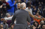 Connecticut's Jalen Adams, back, celebrates with head coach Dan Hurley during the second half of an NCAA college basketball game against Tulane, Saturday, Jan. 19, 2019, in Storrs, Conn. (AP Photo/Jessica Hill)