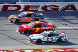 Chase Briscoe (98) races against Justin Allgaier (7) and Noah Gragson (9) during a NASCAR Xfinity series auto race at Talladega Superspeedway Saturday, Oct. 3, 2020, in Talladega, Ala. (AP Photo/John Bazemore)