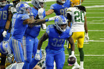 Detroit Lions wide receiver Marvin Jones (11) pats running back Kerryon Johnson (33) after his 2-yard touchdown run during the second half of an NFL football game against the Green Bay Packers, Sunday, Dec. 13, 2020, in Detroit. (AP Photo/Paul Sancya)