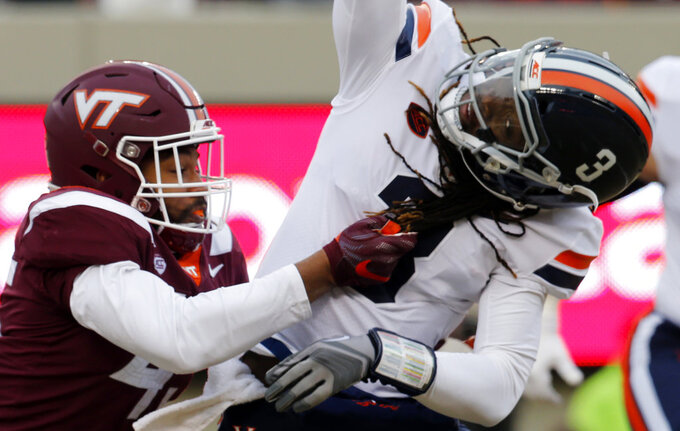Virginia linebacker Reed Kellam, left, grabs the hair of Virginia quarterback Bryce Perkins (3) as he sacks him during the first half of an NCAA college football game in Blacksburg, Va., Friday, Nov. 23, 2018. (AP Photo/Steve Helber)