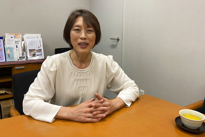 Lawmaker Tomoko Tamura speaks during an interview with The Associated Press at her office in Tokyo on Wednesday, Nov. 4, 2020. Tamura, a lawmaker with the opposition Japanese Communist Party, wants to have the Olympics but said a safe vaccine may not come in time. Even if it does, some might not have access.(AP Photo/Yuri Kageyama)