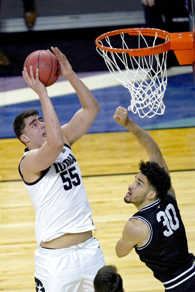 Iowa's Luka Garza (55) shoots over Grand Canyon's Gabe McGlothan during the first half of a first round NCAA college basketball tournament game Saturday, March 20, 2021, at the Indiana Farmers Coliseum in Indianapolis. (AP Photo/Charles Rex Arbogast)