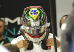 Mercedes' driver Lewis Hamilton, of Britain, wears his helmet designed with an image of the Brazil's national flag, during the first free practice at the Interlagos race track in Sao Paulo, Brazil, Friday, Nov. 15, 2019. Brazil Formula 1 GP will take place on Sunday. (AP Photo/Silvia Izquierdo)