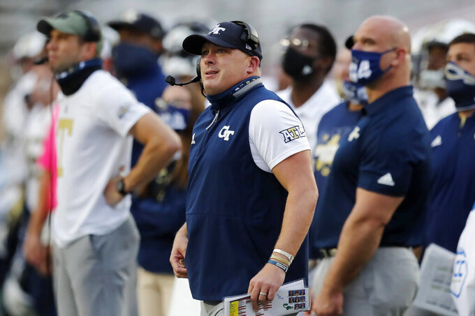 Georgia Tech head coach Geoff Collins watches a Boston College point during the first half of an NCAA college football game, Saturday, Oct. 24, 2020, in Boston. (AP Photo/Michael Dwyer)