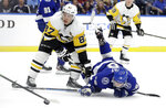 Pittsburgh Penguins center Sidney Crosby (87) takes down Tampa Bay Lightning left wing Ondrej Palat (18) after Palat got off a shot during the second period of an NHL hockey game Wednesday, Oct. 23, 2019, in Tampa, Fla. (AP Photo/Chris O'Meara)