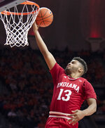 Indiana forward Juwan Morgan shoots a layup during the second half of the team's NCAA college basketball game against Illinois in Champaign, Ill., Thursday, March 7, 2019. (AP Photo/Stephen Haas)