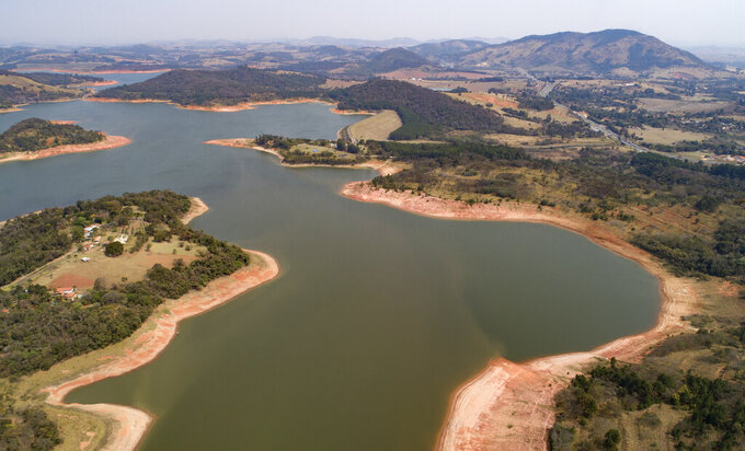 FILE - In this Aug. 25, 2021 file photo, a general view of the Jaguari dam, which is part of the Cantareira System, responsible for providing water to the Sao Paulo metropolitan area, during a drought in Braganca Paulista, Brazil. Brazil is in the throes of its worst drought in 91 years, which has returned the spectre of power rationing. (AP Photo/Andre Penner, File)