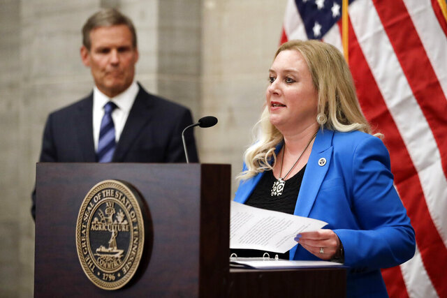 Tennessee Health Commissioner Dr. Lisa Piercey, right, talks about the continuing battle against the coronavirus pandemic during a news conference Wednesday, July 1, 2020, in Nashville, Tenn. At left is Gov. Bill Lee. (AP Photo/Mark Humphrey)