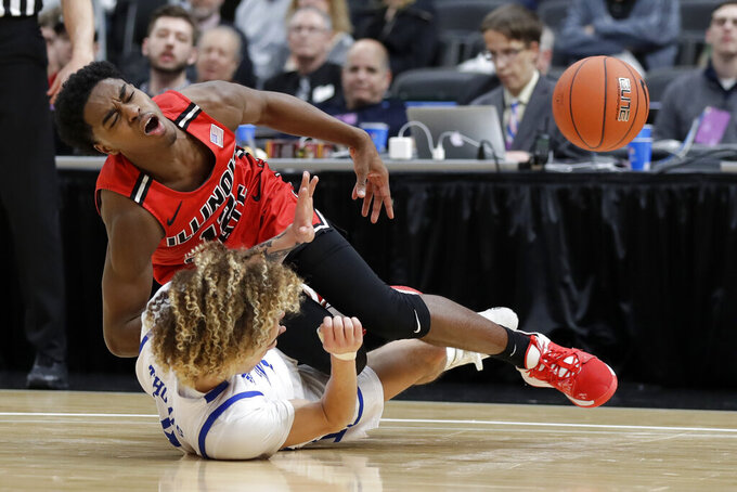 Illinois State's Antonio Reeves, top, loses control of the ball as he collides with Drake's Noah Thomas during the second half of an NCAA college basketball game in the first round of the Missouri Valley Conference men's tournament Thursday, March 5, 2020, in St. Louis. (AP Photo/Jeff Roberson)