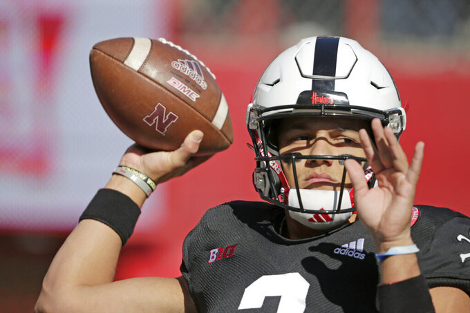 Nebraska quarterback Adrian Martinez (2) warms up before an NCAA college football game against Indiana in Lincoln, Neb., Saturday, Oct. 26, 2019. (AP Photo/Nati Harnik)