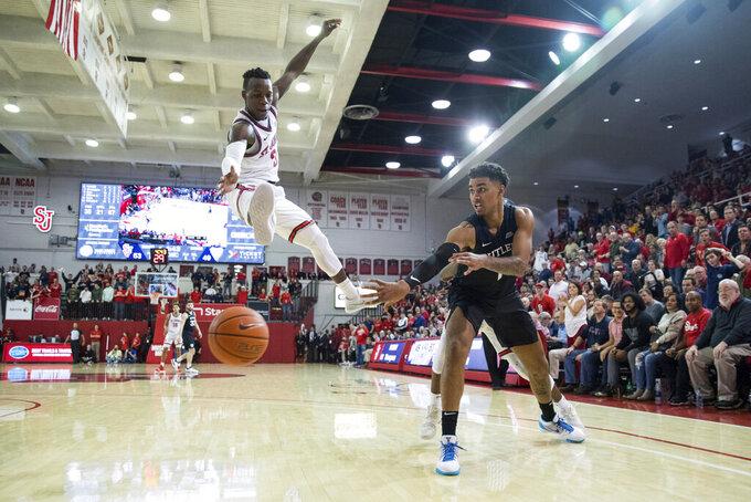 Butler forward Jordan Tucker (1) passes the ball past St. John's guard Rasheem Dunn (3) during the second half of an NCAA college basketball game, Tuesday, Dec. 31, 2019, in New York. (AP Photo/Julius Constantine Motal)