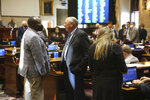State Rep. Michael Rivers, left, D-St. Helena Island, and Rep. Bill Chumley, right, R-Woodruff, speak on the South Carolina House floor on Wednesday, Dec. 2, 2020, in Columbia, S.C. The House ended its two day organizational session on Wednesday. (AP Photo/Jeffrey Collins)