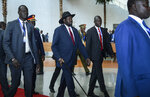 South Sudan's President Salva Kiir, center, arrives for the opening session of the 33rd African Union (AU) Summit at the AU headquarters in Addis Ababa, Ethiopia Sunday, Feb. 9, 2020. Topics on the table for discussion included the situations in Libya and Sudan, as well as President Donald Trump's Middle East initiative. (AP Photo)