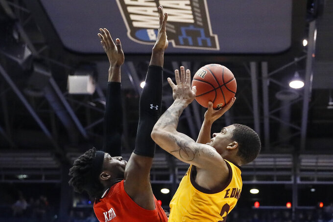 Arizona State's Rob Edwards, right, shoots over St. John's Sedee Keita during the first half of a First Four game of the NCAA men's college basketball tournament Wednesday, March 20, 2019, in Dayton, Ohio. (AP Photo/John Minchillo)