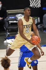 Georgia Tech forward Moses Wright (5) scores against Kentucky during the first half of an NCAA college basketball game Sunday, Dec. 6, 2020, in Atlanta. (AP Photo/John Bazemore)