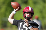 FILE - In this Aug. 2, 2019, file photo, Iowa State quarterback Brock Purdy throws a pass during an NCAA college football practice in Ames, Iowa. The Cyclones, picked third in the preseason poll, have arguably the best defense in the league and a potential star on the rise in sophomore quarterback Brock Purdy.(AP Photo/Charlie Neibergall, File)