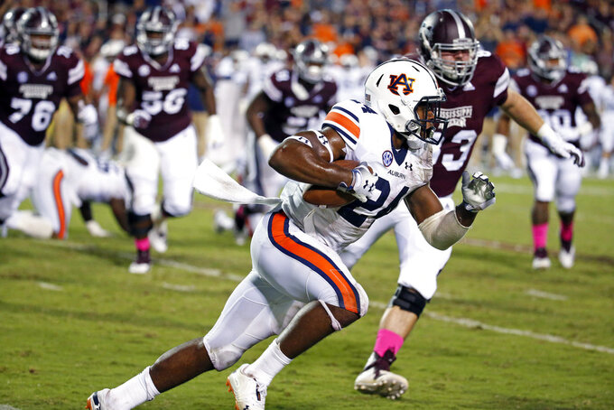 Auburn quarterback Cord Sandberg (24) sprints past Mississippi State defenders during the second half of an NCAA college football game in Starkville, Miss., Saturday, Oct. 6, 2018. Mississippi State won 23-9. (AP Photo/Rogelio V. Solis)