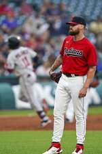 Cleveland Indians starting pitcher Logan Allen, right, waits for Minnesota Twins' Jorge Polanco, back left, to run the bases after hitting a solo home run in the third inning of a baseball game, Monday, Sept. 6, 2021, in Cleveland. (AP Photo/Tony Dejak)