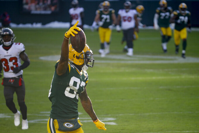 Green Bay Packers' Marquez Valdes-Scantling celebrates after making a 50-yard touchdown catch against Tampa Bay Buccaneers during the first half of the NFC championship NFL football game in Green Bay, Wis., Sunday, Jan. 24, 2021. (AP Photo/Mike Roemer)