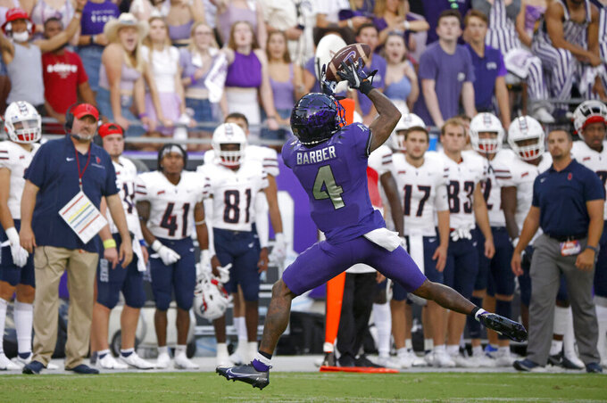 TCU wide receiver Taye Barber (4) catches the ball for a first down against Duquesne during the first half of an NCAA college football game Saturday, Sept. 4, 2021, in Fort Worth, Texas. (AP Photo/Ron Jenkins)