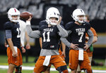 Texas quarterback Sam Ehlinger (11) throws during practice at the Superdome in New Orleans, Friday, Dec. 28, 2018. Texas will face Georgia in the Sugar Bowl NCAA college football game on Jan. 1, 2019. (AP Photo/Gerald Herbert)