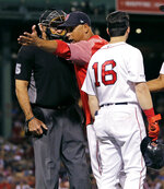 Boston Red Sox manager Alex Cora argues with home plate umpire Angel Hernandez (5) after the ejection of Andrew Benintendi (16) during the fifth inning of a baseball game against the Texas Rangers at Fenway Park in Boston, Tuesday, June 11, 2019. (AP Photo/Charles Krupa)
