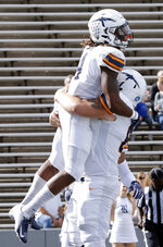 UTEP running back Quardraiz Wadley (4) and offensive lineman Markos Lujan, right, celebrate Wadley's touchdown against Rice during the first half of an NCAA college football game Saturday, Nov. 3, 2018, in Houston. (AP Photo/Michael Wyke)