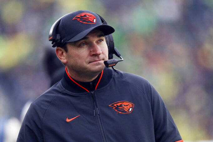 FILE - In this Nov. 30, 2019, file photo, Oregon State head coach Jonathan Smith looks at the scoreboard during the first half of an NCAA college football game against Oregon in Eugene, Ore. Oregon State opens the season against Purdue. (AP Photo/Amanda Loman, File)