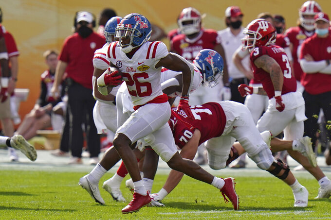 Mississippi defensive back Otis Reese (26) runs with the football after intercepting a pass by Indiana quarterback Jack Tuttle during the first half of the Outback Bowl NCAA college football game Saturday, Jan. 2, 2021, in Tampa, Fla. (AP Photo/Chris O'Meara)