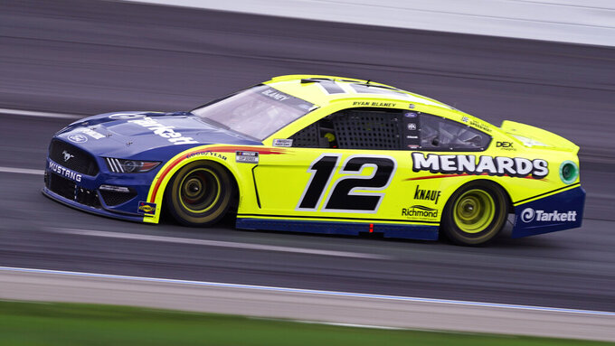 Ryan Blaney competes at a NASCAR Cup Series auto race, Sunday, July 18, 2021, in Loudon, N.H. (AP Photo/Charles Krupa)
